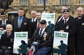 Gulf War veterans protest Gulf War Syndrome opposite the Palace of Westminster on the 20th Anniversary of the end of the first Gulf War. The organisers want to raise awareness of the deteriorating hea... - Justin Tallis - 2010s,2011,activist,ACTIVISTS,age,ageing population,Anniversary,Armed Forces,army,bound,CAMPAIGN,campaigner,campaigners,CAMPAIGNING,CAMPAIGNS,chronic,DEMONSTRATING,DEMONSTRATION,DEMONSTRATIONS,disabil