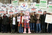 Asda costing us money every day. Pig farmers rally at Downing Street over increasing costs of production. London. - Justin Tallis - ,2010s,2011,a,activist,activists,british,campaign,campaigner,campaigners,campaigning,CAMPAIGNS,capitalism,capitalist,Christine,cost,costs,Davies,DEMONSTRATING,demonstration,DEMONSTRATIONS,domesticated