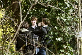 Teenage boys truanting from school hiding in a small wood to smoke a joint. North London. - Justin Tallis - 11-03-2011