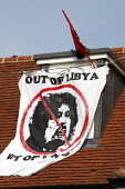Protest group Topple the Tyrants display a Muammar Gaddafi out of Libya banner on the roof of Saif al-Islam Gaddafi house in Hampstead, North London. - Justin Tallis - ,2010s,2011,activist,activists,al-Gaddafi,asset,assets,CAMPAIGN,campaigner,campaigners,CAMPAIGNING,CAMPAIGNS,DEMONSTRATING,DEMONSTRATION,DEMONSTRATIONS,display,displays,gaddafi,Gaddafi's,home,house,ho