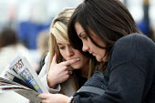 Women Studying the form in The Sporting Post at Cheltenham Racecourse. - Justin Tallis - 16-03-2011