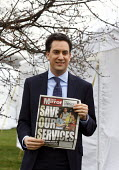Ed Miliband MP posing for a photograph supporting the Daily Mirror newspaper with the headline Save our Services. March for the alternative. Jobs, Growth and Justice. Organised by the TUC. London. - Justin Tallis - 26-03-2011