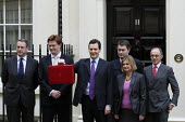 Chancellor George Osborne with the Treasury Team outside 11 Downing Street on budget day 2011. Westminster, London. Mark Hoban, Danny Alexander, David Gauke, Justine Greening, and Lord Sassoon - Justin Tallis - 23-03-2011