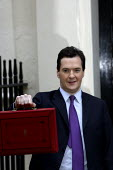 Chancellor George Osborne outside 11 Downing Street on budget day 2011. Westminster, London. - Justin Tallis - 23-03-2011