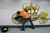 Offenders cleaning a mural of the Royal Carriage on the pedestrian tunnel walls of Hyde Park Corner tube (prior to the Royal wedding) as part of a community payback scheme run by Westminster Council a... - Justin Tallis - 05-04-2011