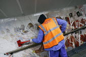 Offenders cleaning the pedestrian tunnel walls (and a mural of Battle of Waterloo) of Hyde Park Corner tube as part of a community payback scheme run by Westminster Council and the London Probation Tr... - Justin Tallis - 05-04-2011