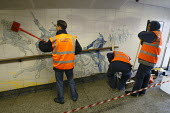 Offenders cleaning the tunnel walls of Hyde Park Corner tube as part of a community payback scheme run by Westminster Council and the London Probation Trust. London. - Justin Tallis - 05-04-2011
