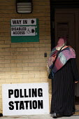 A polling station for voting in local elections as well as a UK wide referendum on the alternative voting system. London. - Justin Tallis - 2010s,2011,alternative,asian,asians,av,BAME,BAMEs,Black,BME,bmes,cast,casting,cities,city,deciding,decision,decisions,democracy,diversity,election,elections,electorate,ethnic,ethnicity,FEMALE,ISLAM,IS