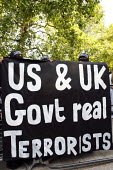 USA and UK are the real terrorists say Muslims Against Crusades, protest against the killing of Osama Bin Laden, American Embassy, London - Justin Tallis - &,2010s,2011,activist,activists,against,Al-Muhajiroun,American,americans,anti,Awad,BAME,BAMEs,belief,bin,BME,bmes,campaign,campaigner,campaigners,campaigning,CAMPAIGNS,conviction,Crusades,dead,death,D