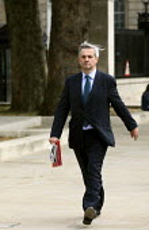 Chris Huhne MP walking along Whitehall. London - Justin Tallis - 16-05-2011