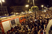 A fire engine being cheered as it drives through crowds of protesters occupying Puerta del Sol square in demonstration over high unemployment and austerity measures prior to regional and municipal ele... - Justin Tallis - ,2010s,2011,activist,activists,adult,adults,against,anti,Austerity,Austerity Cuts,CAMPAIGN,campaigner,campaigners,CAMPAIGNING,CAMPAIGNS,capitalism,capitalist,civil disobedience,DEMONSTRATING,demonstra