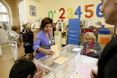 A woman voting at Colegio Pi I Margall in Spains regional elections. Madrid. - Justin Tallis - 22-05-2011