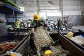 A team of workers doing preliminary dismantling into component parts of waste materials at a specialist waste electrical and electronic equipment processor plant (WEEE) in Kent. - Justin Tallis - 20-05-2011
