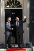 President Barack Obama arrives at Number 10 Downing street to be greeted by Prime Minister David Cameron. London. - Justin Tallis - 2010s,2011,america,BAME,BAMEs,Black,BME,bmes,CONSERVATIVE,Conservative Party,conservatives,Democratic Party,Democrats,diversity,ethnic,ethnicity,Minister,minorities,minority,mp,mps,Obama,of,people,poc