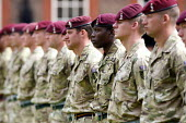 Soldiers from 216 Parachute Signal Squadron wait to receive their operational service medals after completing a tour of duty in Afghanistan. Chelsea, London. - Justin Tallis - 2010s,2011,216,afghan,afghans,and,armed,Armed Forces,army,attention,BAME,BAMEs,BME,bmes,british,ceremonial,ceremonies,ceremony,cities,city,communicating,communication,diversity,ethnic,ethnicity,format