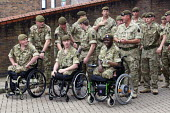Severely disabled soldiers who have had there legs blown off from 1st Battalion Irish Guards waiting to receive their operational medal for a tour of duty in Afghanistan. Victoria Barracks, Windsor. - Justin Tallis - 25-06-2011