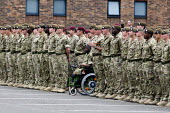 Severely disabled soldier, having had his legs blown off, from 1st Battalion Irish Guards waiting to receive his operational medal for a tour of duty in Afghanistan. Victoria Barracks, Windsor. - Justin Tallis - 25-06-2011
