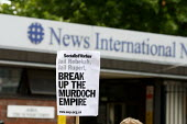 Protesters outside News International during the News of the World phone hacking scandal. Break up the Murdoch Empire, Wapping, London. - Justin Tallis - 08-07-2011