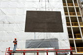 Construction workers raise a large concrete wall at 5 Hanover Square in London. - Justin Tallis - 02-08-2011