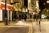 Youths vandalise parts of the high street in Hackney. Rioting and looting has today spread to many places in London, and around England, after Mark Duggan, 29, was killed by police on Thursday. - Justin Tallis - 08-08-2011