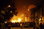 Youths set fire to a van on a street in Hackney. Rioting and looting has today spread to many places in London, and around England, after Mark Duggan, 29, was killed by police on Thursday. - Justin Tallis - 08-08-2011