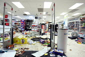 Smashed windows and looted sheaves of Somerfield supermarket after rioting and looting has spread to many places in London, and around England, after Mark Duggan, 29, was killed by police. - Justin Tallis - 09-08-2011