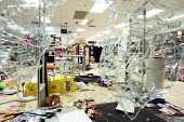 Smashed windows and looted shelves of Somerfield supermarket after rioting and looting spread to many places in London, and around England after Mark Duggan, 29, was killed by police, London - Justin Tallis - 09-08-2011