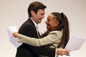 Yvonne Sharples, Headteacher of Parklands High School in Speke, hugging Andy Burnham MP at the Labour Party Conference. Liverpool. - Justin Tallis - ,2010s,2011,BAME,BAMEs,Black,BME,bmes,diversity,EMBRACE,EMBRACING,ethnic,ethnicity,FEMALE,HEAD TEACHER,Heads,Headteacher,HEADTEACHERS,HUG,hugging,hugs,minorities,minority,Party,people,person,persons,p