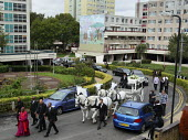 The funeral cortege with a horse drawn carriage carrying the body of Mark Duggan drives through the Broadwater Farm Estate in North London. Duggan, 29, a father of four, was shot by police on 4th Augu... - Justin Tallis - ,2010s,2011,adult,adults,animal,animals,bodies,body,carriage,carriages,carries,carry,carrying,cities,city,Clj,DAD,DADDIES,DADDY,DADS,death,death in police custody,deaths,died,domesticated ungulate,dom
