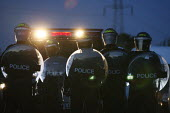 Riot police gather at dawn to begin the eviction of Dale Farm. Basildon. Essex. - Justin Tallis - 19-10-2011