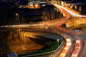 Traffic flowing into and out of Newport at night. South Wales. - Justin Tallis - 01-12-2004