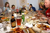 Family eating Christmas dinner - Justin Tallis - 2000s,2004,alcohol,beer,bottle,bottles,BREAK,CELEBRATE,celebrating,christmas,day,diet,diets,dine,dining,dinner,dinners,DINNERTIME,down,drink,drinking,drinks,Eating,eats,Evening,families,family,FEMALE,