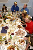 Family eating Christmas dinner - Justin Tallis - ,2000s,2004,alcohol,BREAK,CELEBRATE,celebrating,christmas,day,diet,diets,dine,dining,dinner,dinners,DINNERTIME,down,drink,drinking,drinks,Eating,eats,Evening,families,family,FEMALE,food,FOODS,gastrono