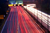 Traffic flowing from the M4 out of Cardiff - Justin Tallis - 2000s,2005,at,AUTO,AUTOMOBILE,AUTOMOBILES,AUTOMOTIVE,blur,Blurs,car,cars,cities,city,congested,congestion,dark,ebf economy,eni environmental issue,evening,exposure,exposures,flow,flowing,highway,Long,