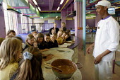 Pupils from Stratford County Primary School watching workers make chocolate at Cadbury World, Bournville - Justin Tallis - 2,2000s,2005,attention,attentive,BME Black minority ethnic,Cadbury,child,CHILDHOOD,children,chocolate,day out,EDU Education,educational,EMOTION,EMOTIONAL,EMOTIONS,enjoy,Enjoying,ENJOYMENT,enjoys,HAPPI