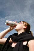 Teenager drinking a can of larger in a park - Justin Tallis - 22-06-2005