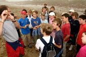 Pupils from Stratford County Primary School are learning about different types of rocks on a beach. The year six pupils are on a residential trip to the Isle of Wight - Justin Tallis - 2,2000s,2005,6,Beach,BEACHES,Being,boy,boys,child,CHILDHOOD,children,class,COAST,coastal,coasts,communicating,communication,EDU Education,female,females,fossil,fossils,geology,girl,girls,group,groups,