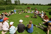 Pupils from Stratford County Primary School learning about the workings of a farm at Brandstone farm. The year six pupils are on a residential trip to the Isle of White - Justin Tallis - 28-06-2005