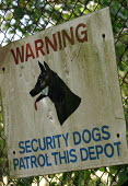 Sign warning alerting people to the presence of security dogs. Warwickshire - Justin Tallis - 2000s,2005,animal,animals,canine,CLJ Crime,communicating,communication,depot,DEPOTS,dog,dogs,fence,guard,Patrol,secure,security,sign,signs,warning,warns,Warwickshire