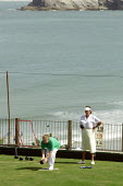 Elderly women playing bowls by the seaside. Newquay - Justin Tallis - 23-08-2005