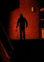 Silhouette of a skateboarder - Justin Tallis - 2000s,2005,adolescence,adolescent,adolescents,at,boy,boys,child,CHILDHOOD,children,cities,city,dark,darkness,EXTREME,hobbies,hobby,hobbyist,juvenile,juveniles,kid,kids,LFL leisure,light,lighting,light