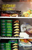 Cheap pizza's stacked up high in a student fridge at the University of Newport, South Wales - Justin Tallis - 15-11-2005