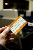 A cheap day return train ticket costing over ten percent more than one week before - Justin Tallis - 2000s,2006,adult,adults,COMMUTE,commuter,commuters,commuting,day,EBF Economy,fare,fares,First Great Western,from work,hand,hold,holding,increase,journey,journey to,JOURNEYS,lfl,LIFE,lifestyle,MATURE,n