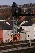 Network Rail workers carrying out maintenance checks on the tracks. Newport South Wales - Justin Tallis - 10-02-2006