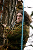 Eco Warrior Olly Carter and Up to 25 campaigners have joined to fight plans to chop down trees at the site of a planned Tesco supermarket. Underground tunnels and 60ft tree houses have been built. Som... - Justin Tallis - 23-02-2006