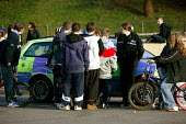 Group of teenagers being stopped by the police. Somerset. - Justin Tallis - 2000s,2006,adolescence,adolescent,ADOLESCENTS,adult,adults,afternoon,anti social behavior,anti social behaviour,anti socialanti social behavior,antisocial,antisocial behaviour,AUTO,AUTOMOBILE,AUTOMOBI
