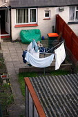 Pensioner putting his washing out on the line. - Justin Tallis - 01-04-2006