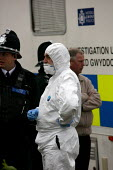 Forensic Scientist and uniformed police officers at the scene of a suspected domestic murder. Newport, South Wales - Justin Tallis - 09-05-2006