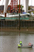 Sections of a new �5 million footbridge being lowered into place in a large scale construction project in the centre of Newport, South Wales. The footbridge is being built over the River Usk as the fi... - Justin Tallis - 2000s,2006,a,a-frame,boat,boats,bridge,bridges,building site,civil,Construction Industry,developer,developers,DEVELOPMENT,EBF Economy,engineer,engineering,engineers,equipment,footbridge,FOOTBRIDGES,fr