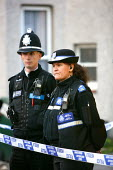 Police officers standing guard of a crime scene. Newport, South Wales - Justin Tallis - 09-05-2006